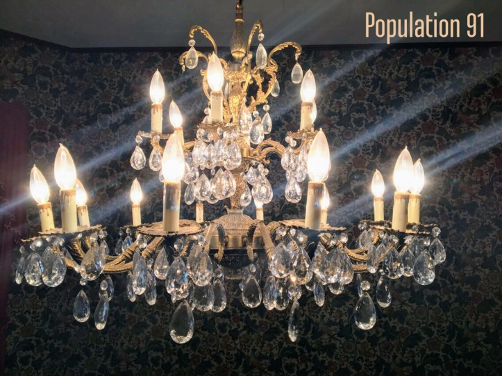 A chandelier at the Moore Home in Charleston, Missouri. Image by Laura (Abernathy) Huffman for Population 91