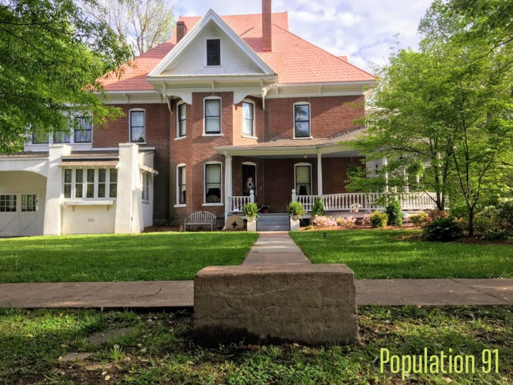 The Moore Home south sidewalk ends with a carriage step. There are several surviving examples of carriage steps in Charleston, MO. Image by Laura (Abernathy) Huffman for Population 91.